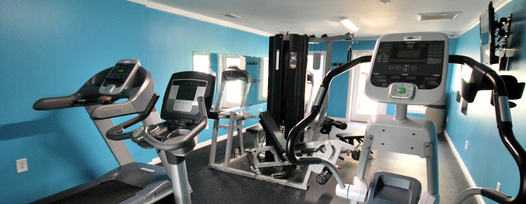 Cardio and weight equipment in the fitness center at Hunter's Ridge