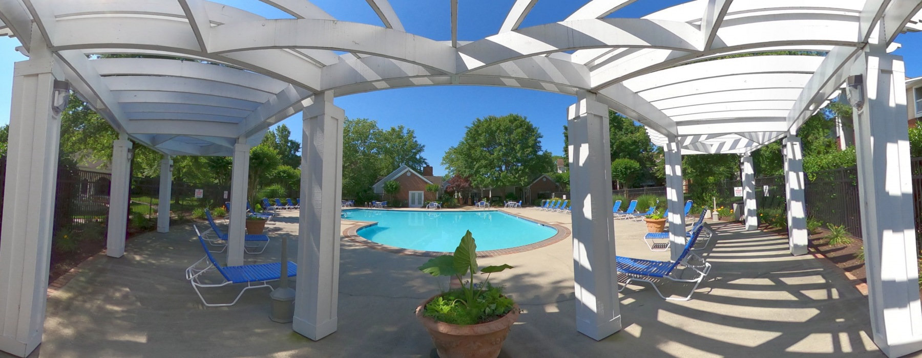 Wide angle photo of pergola at swimming pool