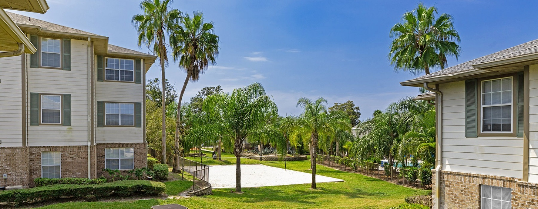 Tropically landscaped grounds with picnic areas and volleyball