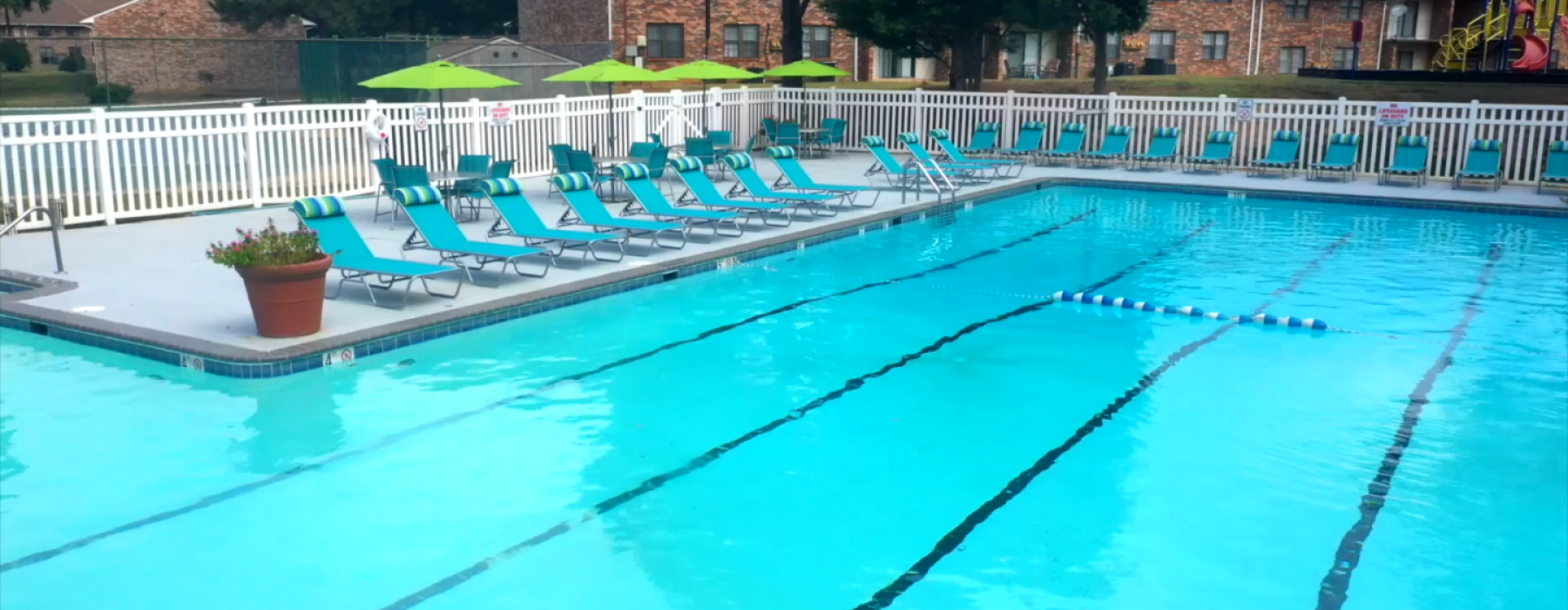 Olympic sized swimming pool with lounge chairs on the deck