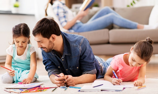 Lifestyle Image Of Family Enjoying Time Together in Living Space