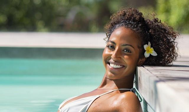Lifestyle Image Of Woman Enjoying the Swimming Pool