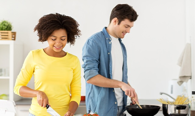 A young couple cooking together