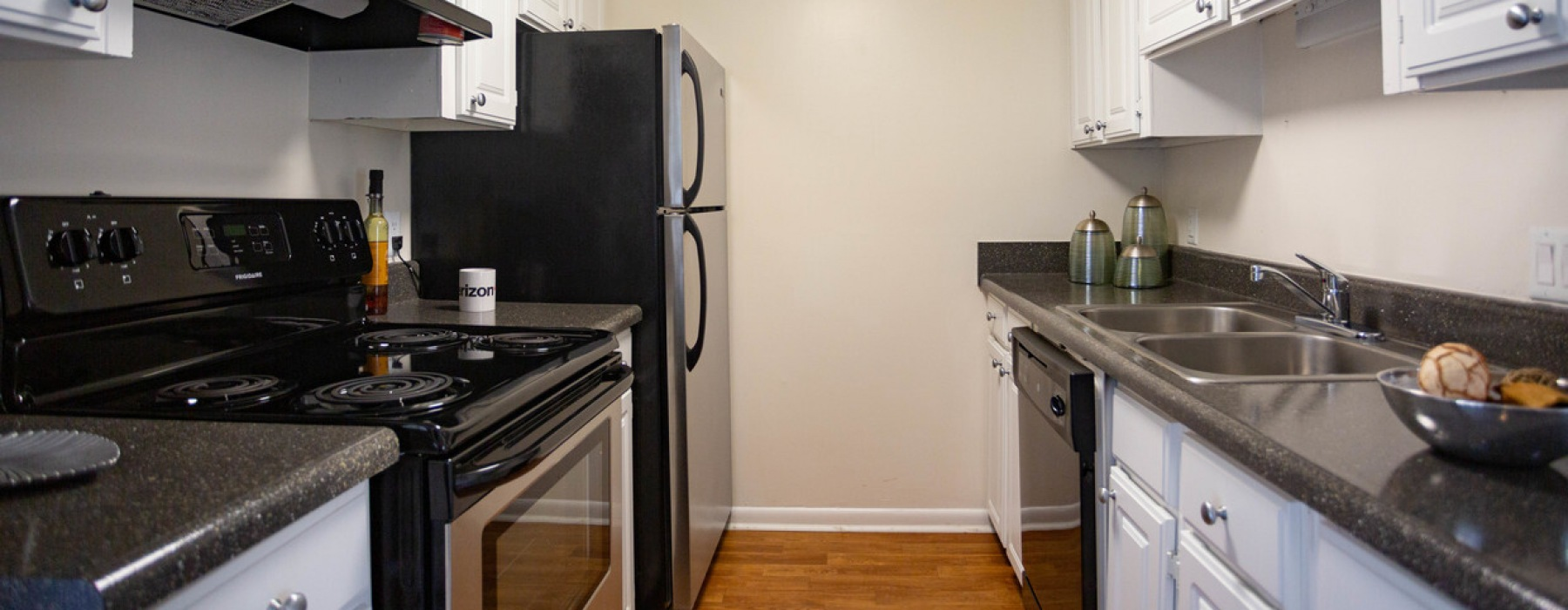 Stainless steel kitchen appliances and renovated, white cabinets