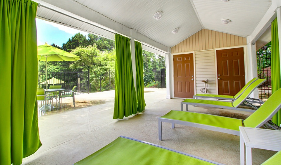 spacious cabana area with sectional curtains and adjustable lounge chairs