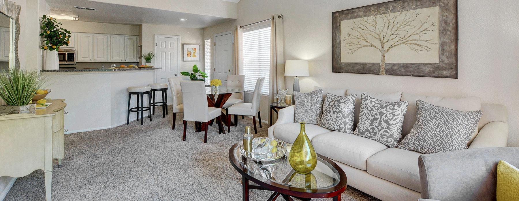 open layout living room, dining area and kitchen counter stool area