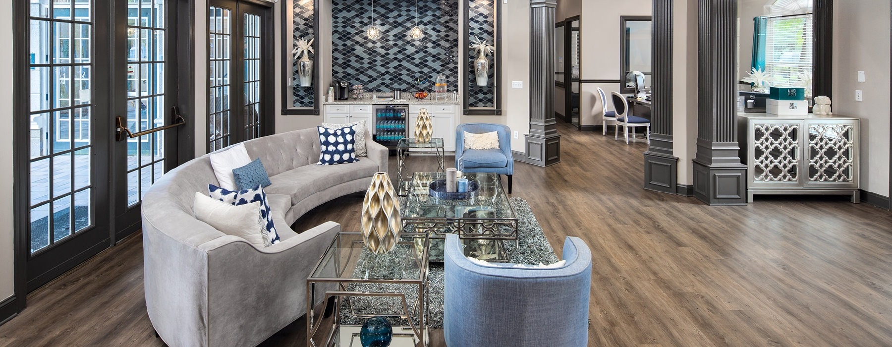 bright, open concept clubhouse with seating areas