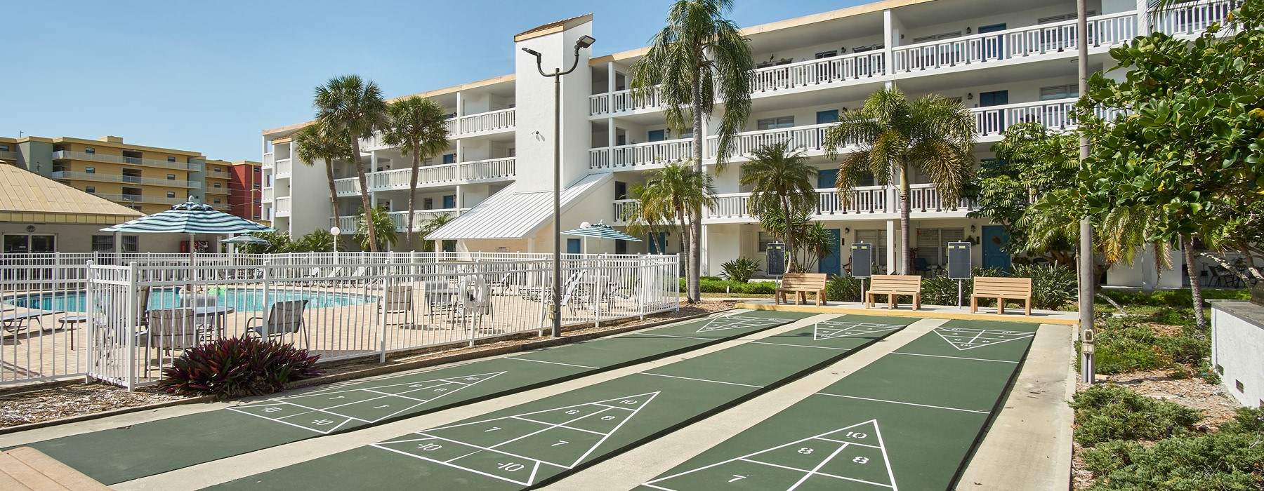 shuffle board courts next to swimming pool
