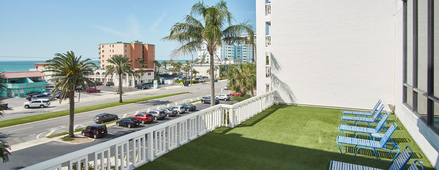 patio with ocean and neighborhood views