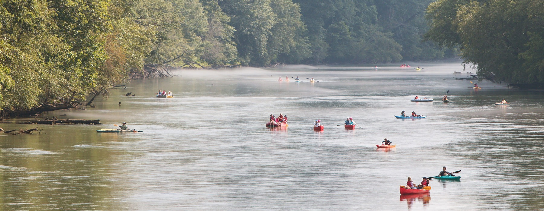 people boating and kayaking down the Chattahoochee River