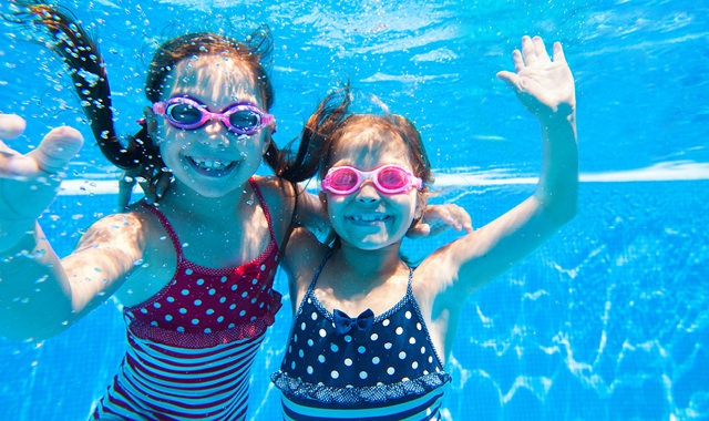 children having underwater fun in pool