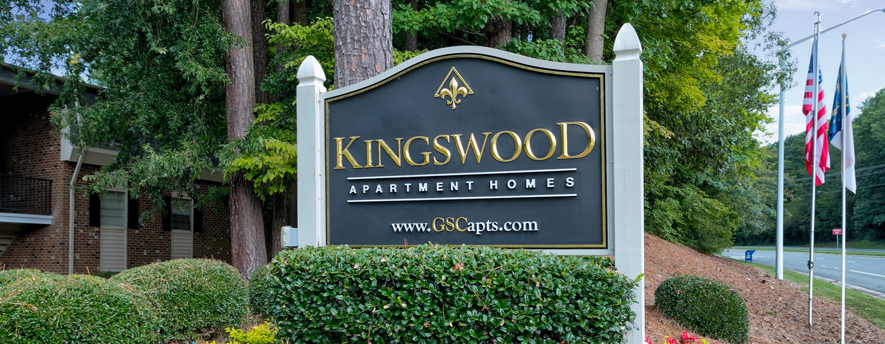 kingswood sign at property entrance along the street