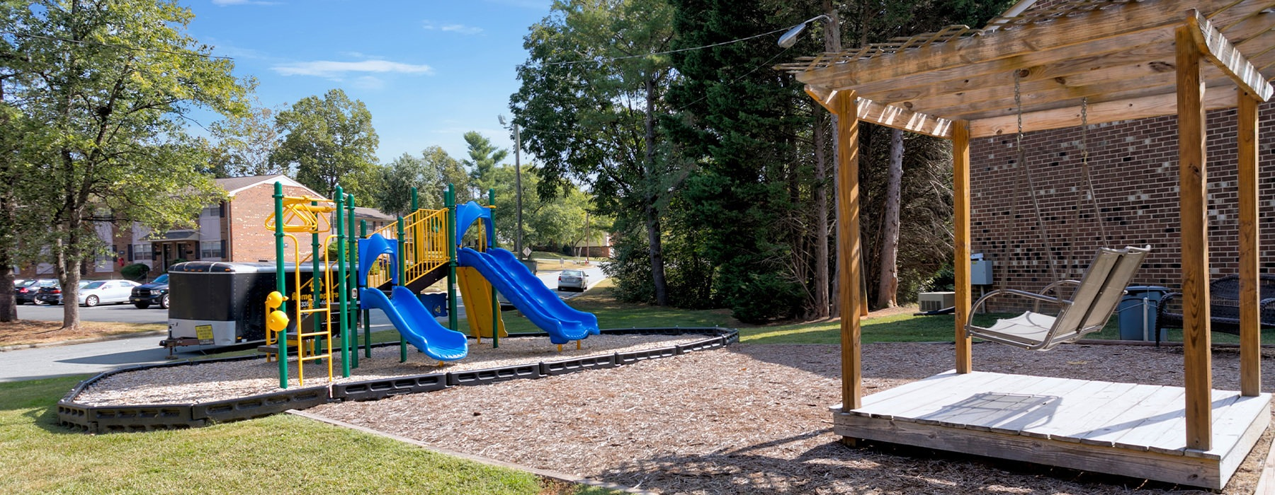 An outdoor playground and seating area