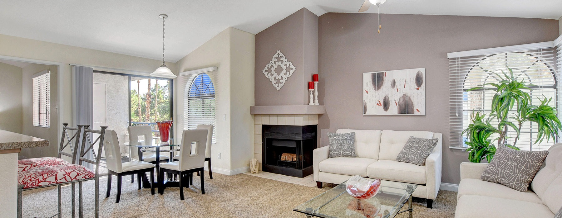 brightly lit open concept living room