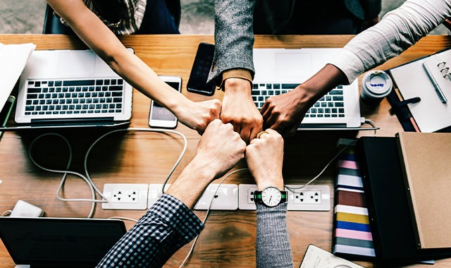 Friends working together in an office