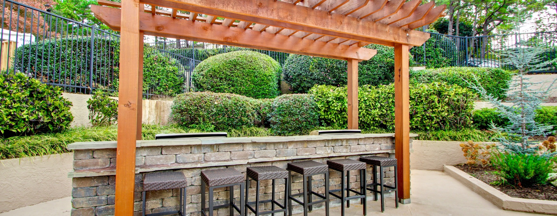 Pull up a chair at our outdoor pergola and grill