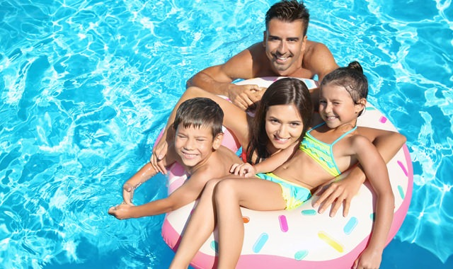 Lifestyle Image of a Family in a Pool