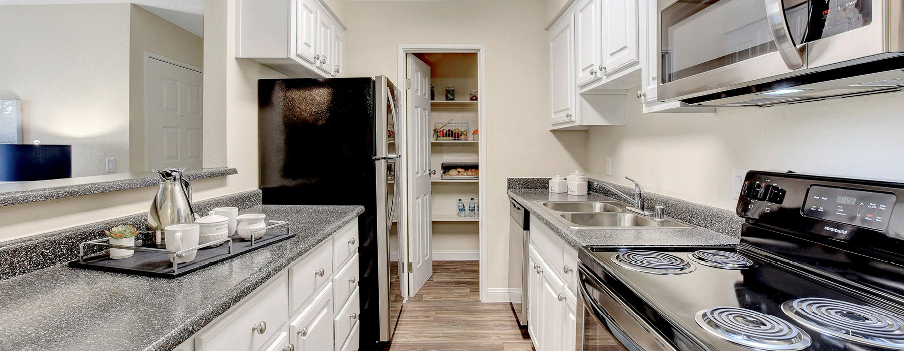 galley kitchen with pantry and bright lighting