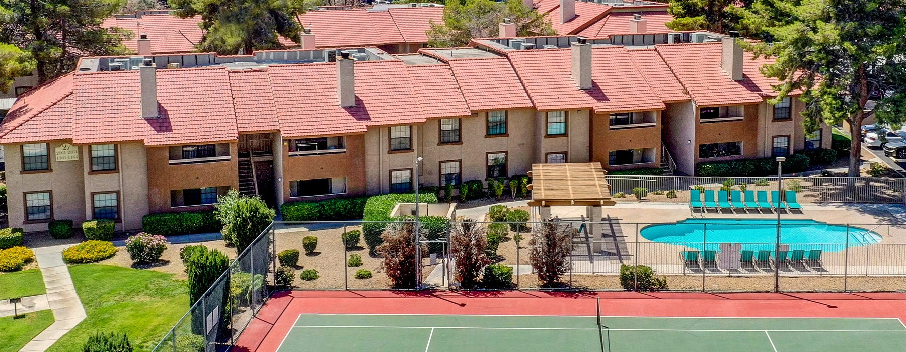 view of tennis courts and pool in front of Rancho Del Sol