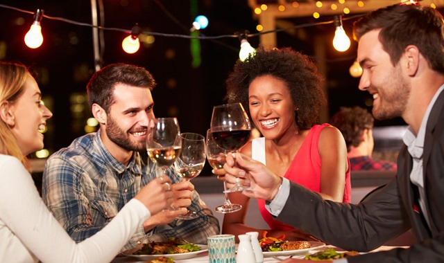 Lifestyle Image Of Couples Enjoying an Evening Dining