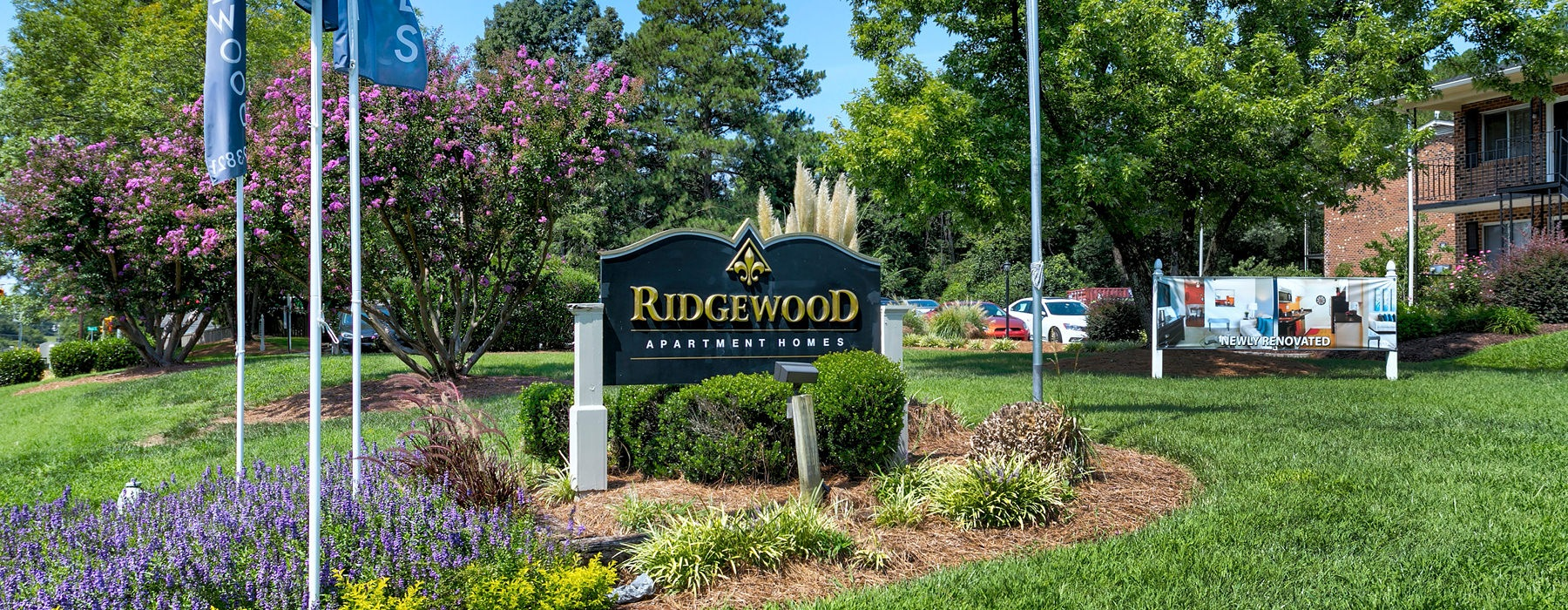 ridgewood property sign at the front of apartment complex