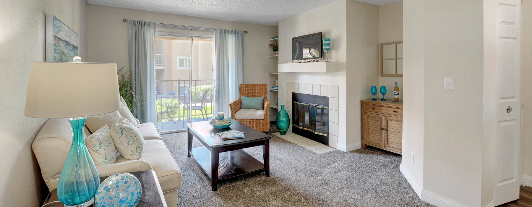 living room includes sliding glass door providing access to private patio