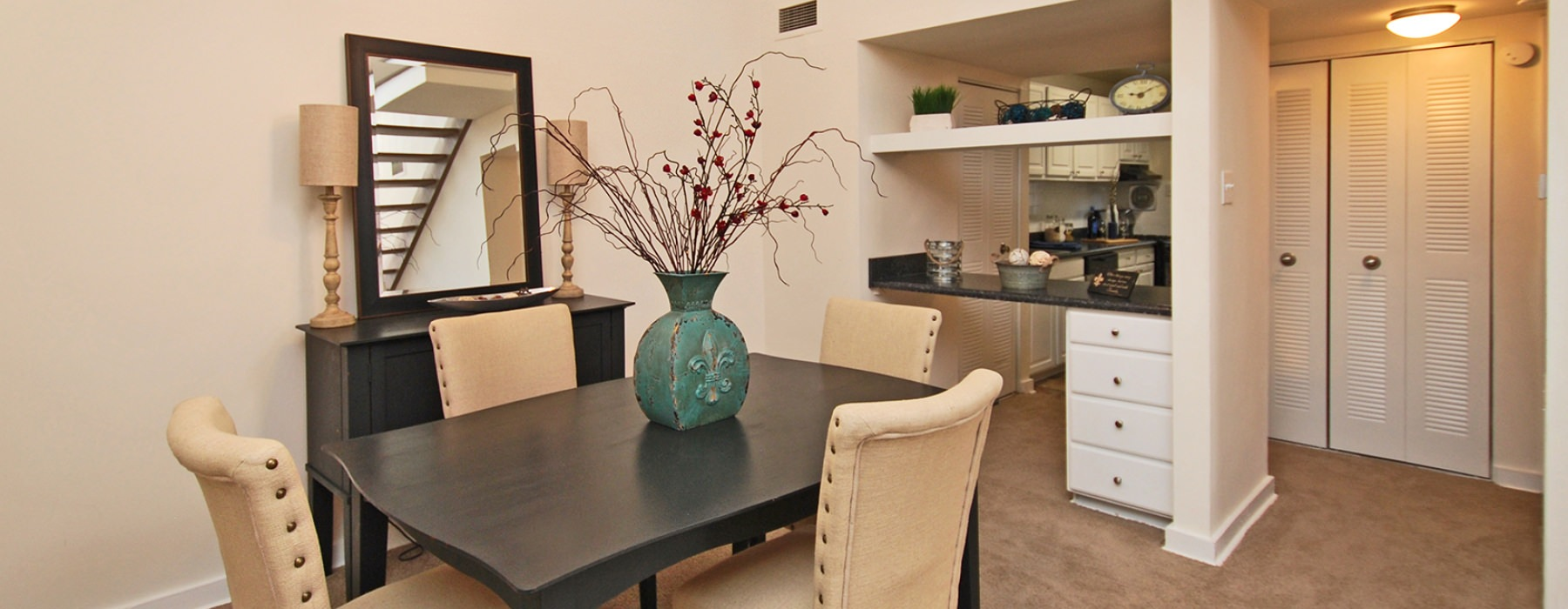 open rossmore dining area with view of the kitchen