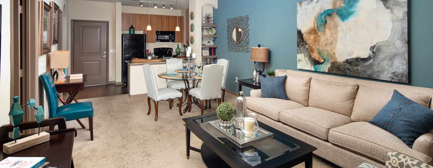 open and brightly lit living room with accent wall