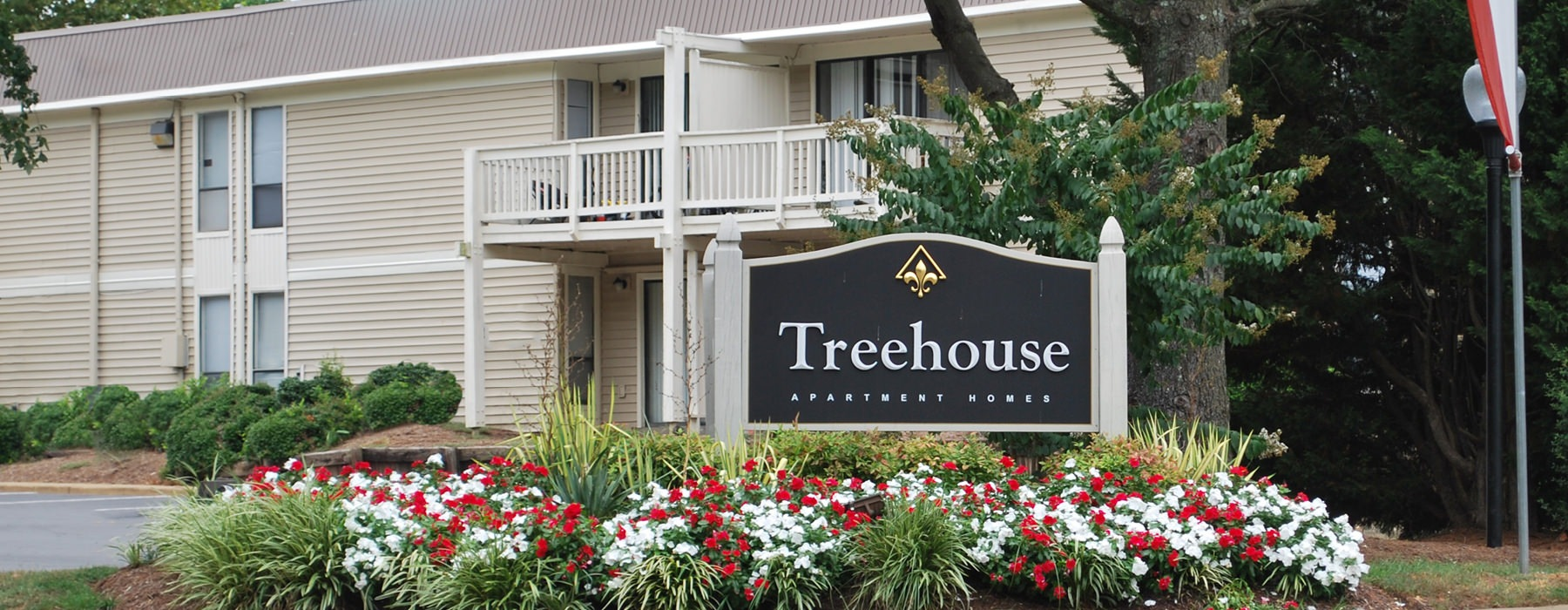 treehouse property entrance sign in front of complex
